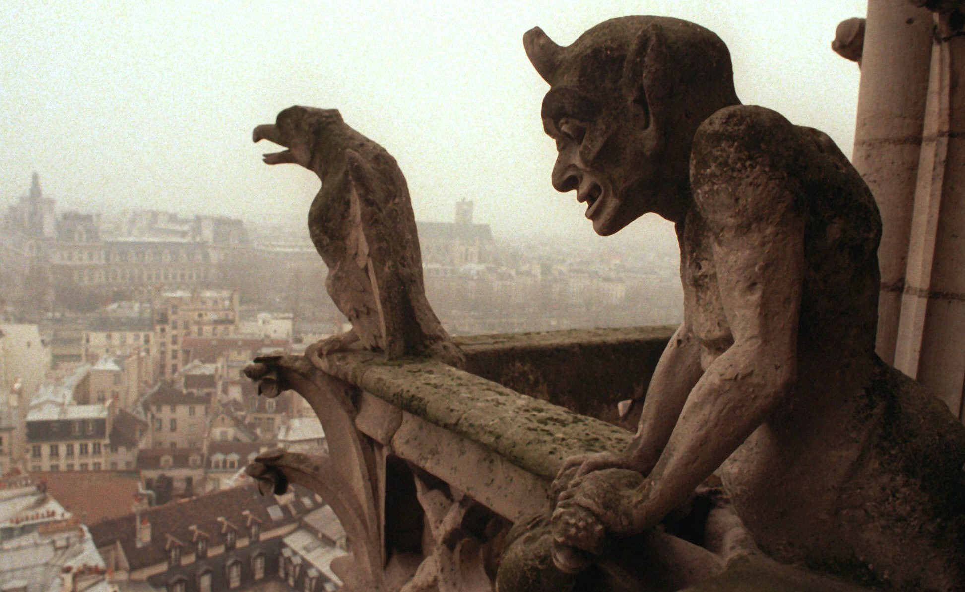 """Gargoyles watch over the streets of Paris from the top of the 11th century Notre Dame cathedral, Friday Jan 10, 1997. Notre Dame and its gargoyles are one of the typical features of medieval Paris pictured in Walt Disney's """" Hunchback of Notre Dame"""", France's second-most popular film behind 1996's other mega hit, """"Independence Day"""". (AP Photo/Remy de la Mauviniere)"""