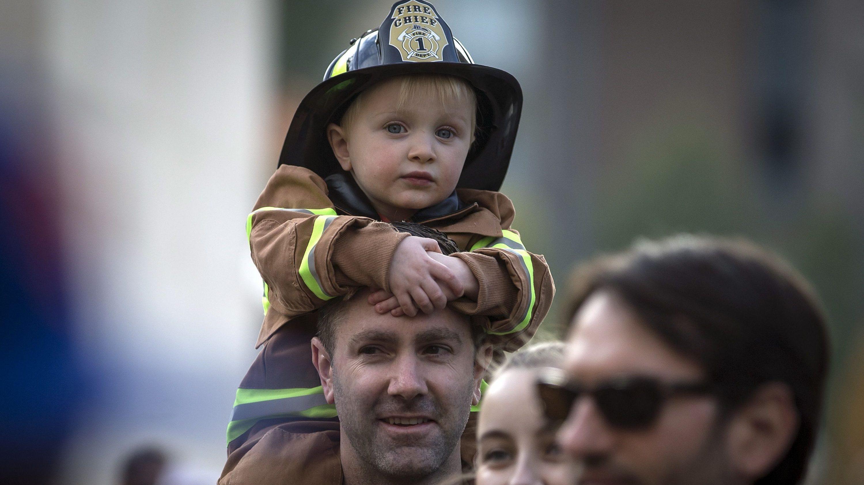kid dressed as fireman