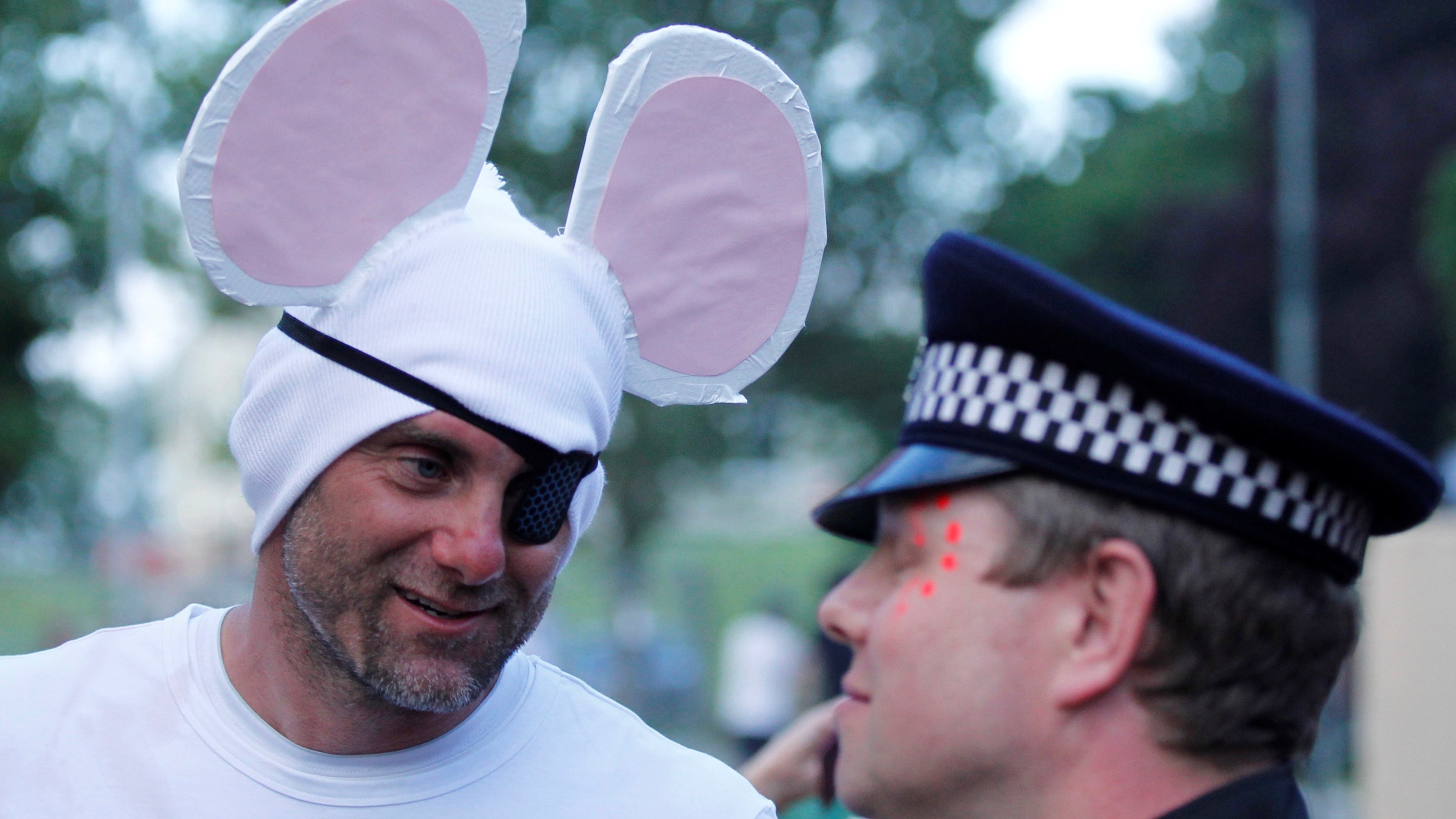 A man dressed as a mouse.