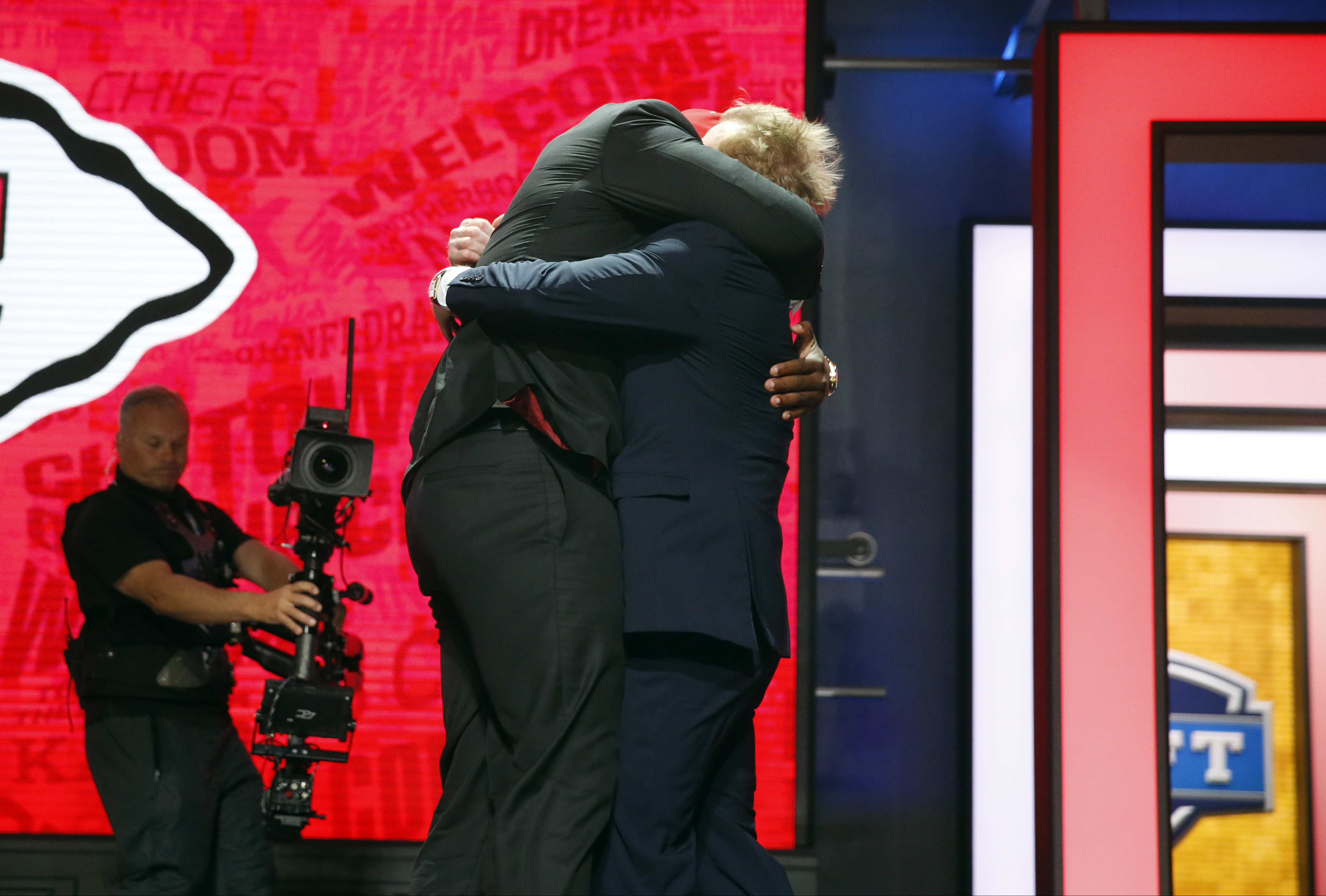 Mississippi State's Chris Jones celebrates with NFL Commissioner Roger Goodell after being selected by the Kansas City Chiefs as the 37th pick in the second round of the 2016 NFL football draft, Friday, April 29, 2016, in Chicago.