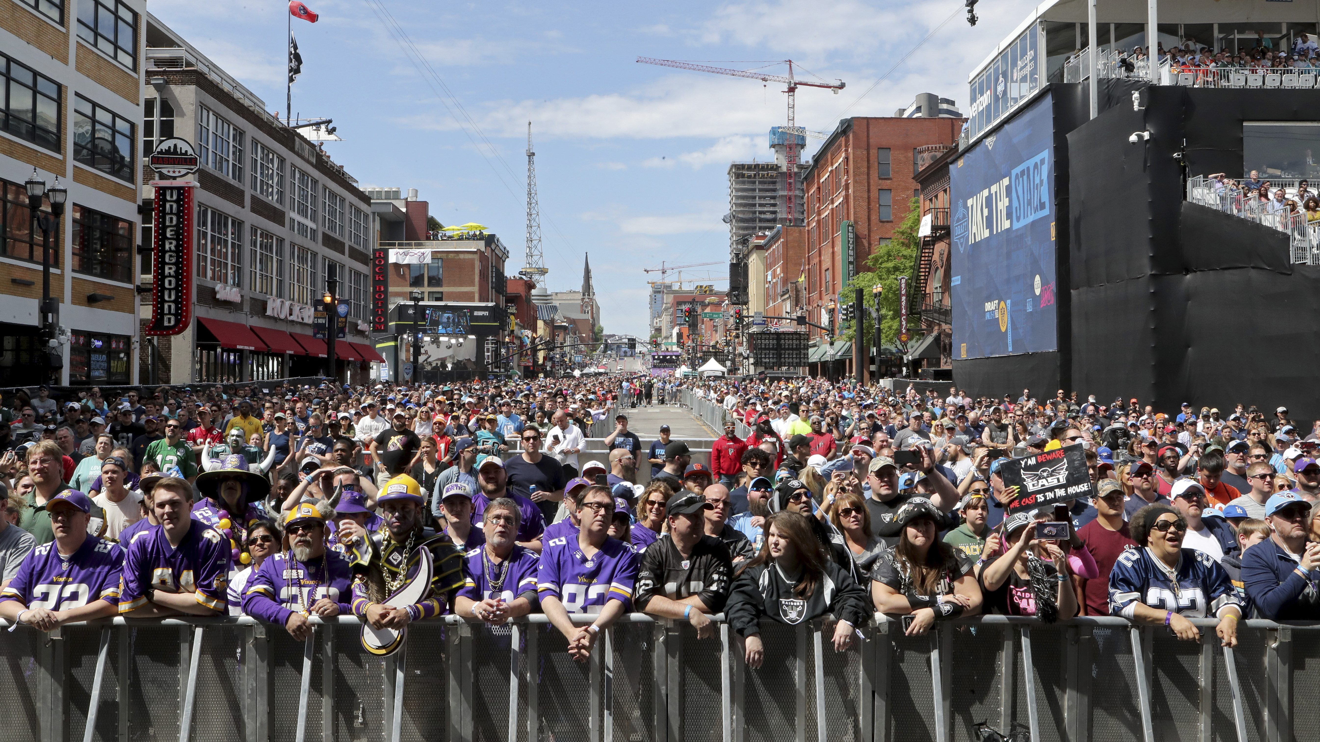 Fans line Broadway before the start of Day 3 of the NFL football draft, in Nashville, Tenn. on Saturday, April 27, 2019.