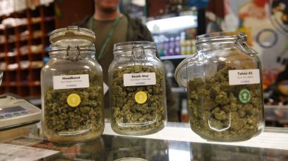 Jars of marijuana buds sit on the counter at the Denver Kush Club in north Denver. A simplified program will make it easier for thousands of people to seek the elimination of low-level marijuana convictions that occurred in Denver before recreational use became legal in Colorado, officials said Wednesday, Jan. 9, 2019.