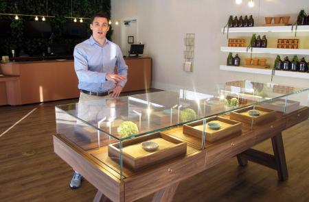Pat Doherty, director of new market development for Acreage Holdings, describes products inside a display case at The Botanist in Fargo, N.D., Thursday, Feb. 28, 2019. The business located in a south-side mini-mall is North Dakota's first medical marijuana dispensary. North Dakota voters approved the drug in November 2016, after lawmakers refused to do it. ()