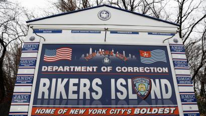 Rikers department of corrections sign.