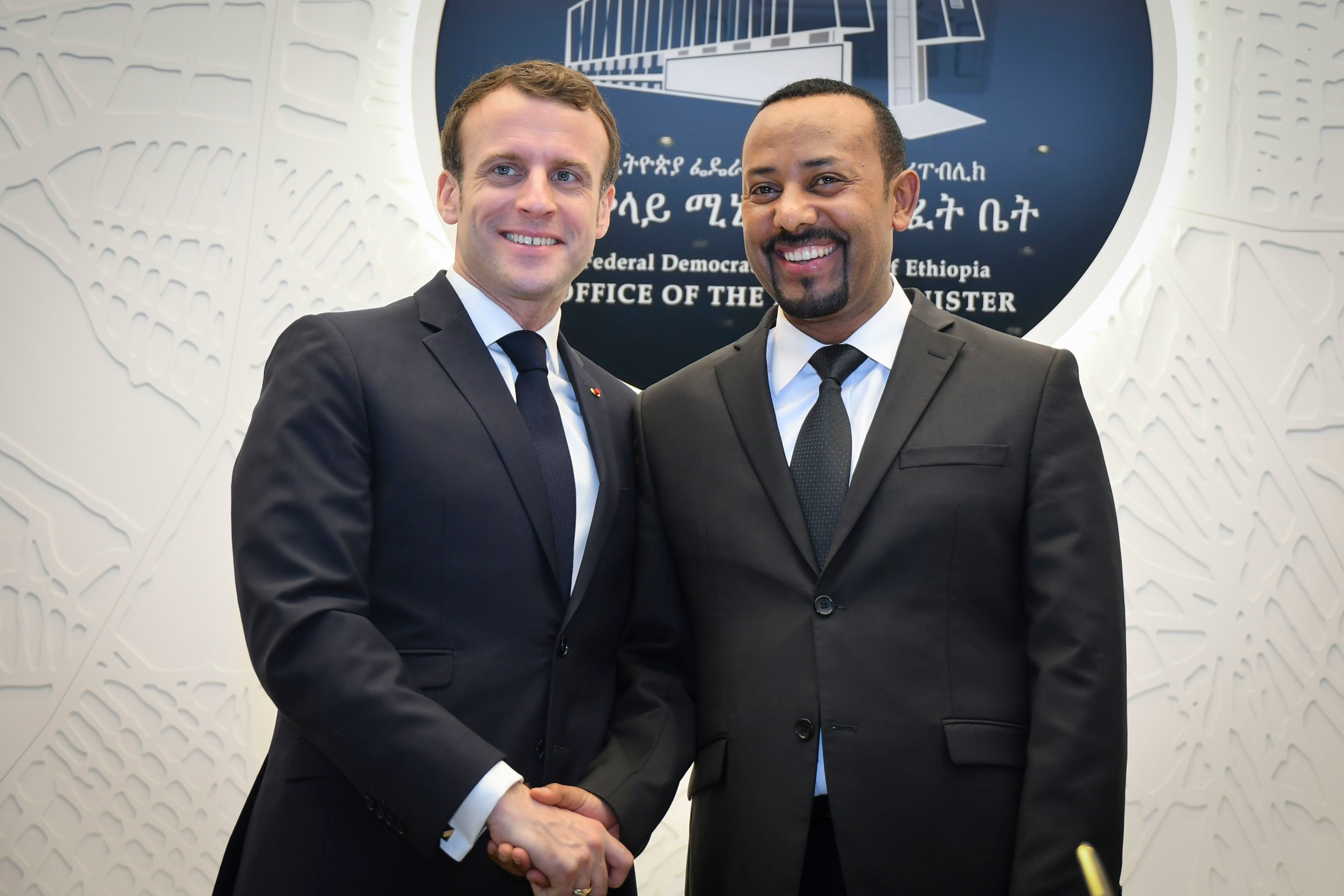 President of France Emmanuel Macron (L) and the Prime Minister of Ethiopia Abiy Ahmed (R) shake hands as they pose for photographers during their meeting at the premier's office in Addis Ababa, Ethiopia, 12 March 2019. Macron is in the country after visiting Djibouti during his four-day tour of the East African countries that will also take him to Kenya the following day. His first visit to the region aims to strengthen bilateral relationships with non-Francophone African nations. French President Emmanuel Macron visits Ethiopia, Addis Ababa - 12 Mar 2019