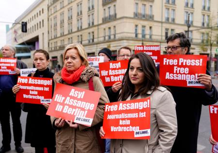 Dieter Dehm (R), Sevim Dagdelen (2-R) and Gesine Loetzsch (3-L) of The Left (Die Linke) party attend a rally calling for the release WikiLeaks founder Julian Assange, close to the embassy of the United Kingdom in Berlin, Germany, 12 April 2019. The President of Ecuador withdrew asylum of Assange, after accusing him of violating international agreements, a special protocol of coexistence and participating in a plot of institutional destabilization. Assange was arrested by British authorities on 11 April 2019. Rally calls for Julian Assange's release in Berlin, Germany - 12 Apr 2019