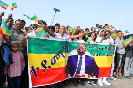 Suporters of Ethiopian Prime Minister Abiy Ahmed cheer just before an explosion rocked a massive rally to support him in Meskel Square in Addis Ababa, Ethiopia, 23 June 2018. Reports say the blast occurred shortly after Abiy addressed thousands of his supporters. Abiy says a few people have been killed. Explosion rocks a rally in Ethiopia, Addis Ababa - 23 Jun 2018