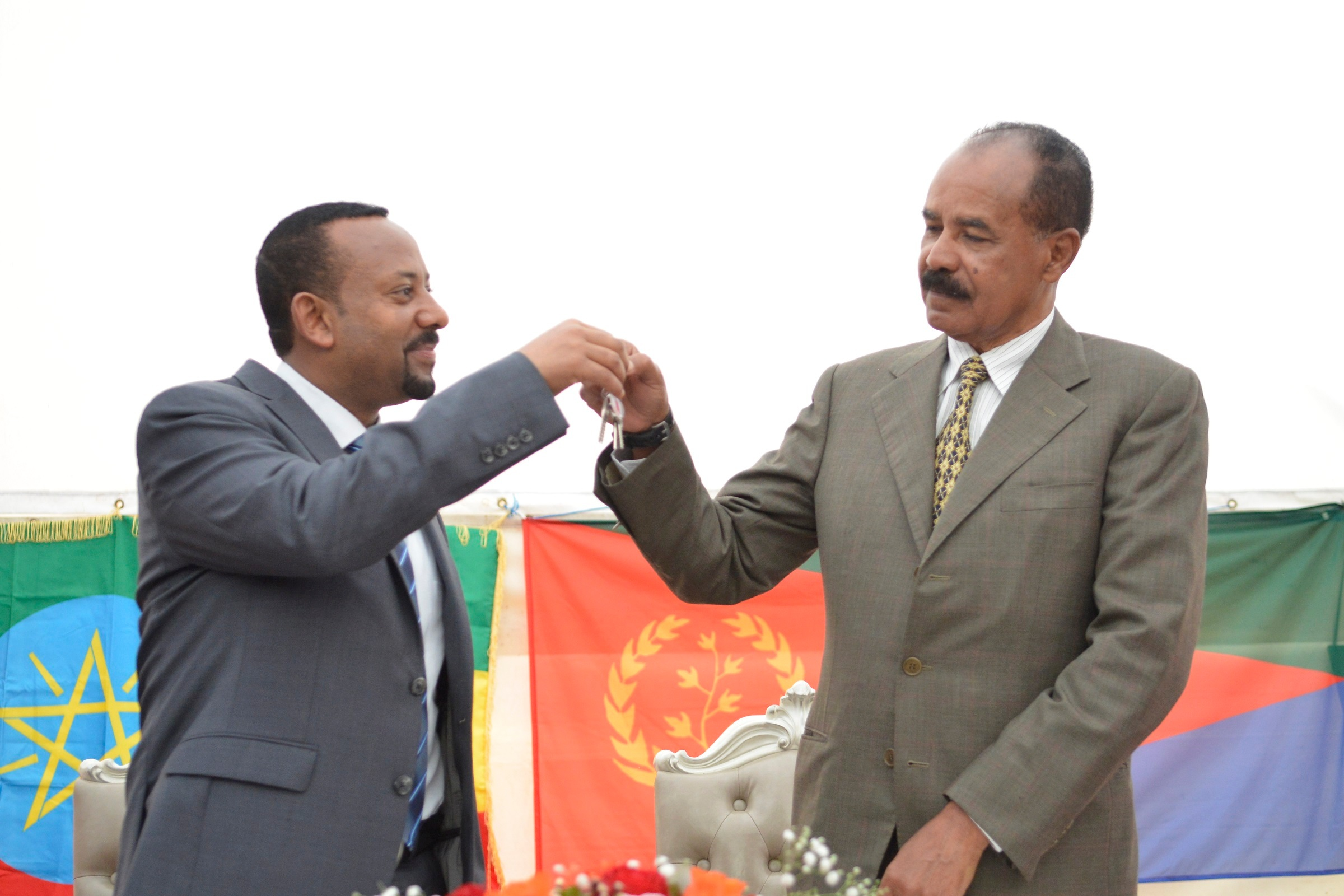Abiy Ahmed and Isaias Afwerki Re-opening of the Eritrean embassy in the Ethiopian capital Addis Ababa, Ethiopia - 16 Jul 2018 Ethiopia's Prime Minister Abiy Ahmed (L) and Eritrea's President Isaias Afwerki (R) attend the re-opening of the Eritrean embassy in the Ethiopian capital Addis Ababa, Ethiopia, in a brief ceremony 16 July 2018. The leaders declared their 'state of war' over one week ago and Isaias spent the weekend in Ethiopia. Eritrea reopened its embassy in Ethiopia 16 July in further evidence of a rapid thaw between two countries that a week ago ended two decades of military stalemate over a border war in which tens of thousands died.