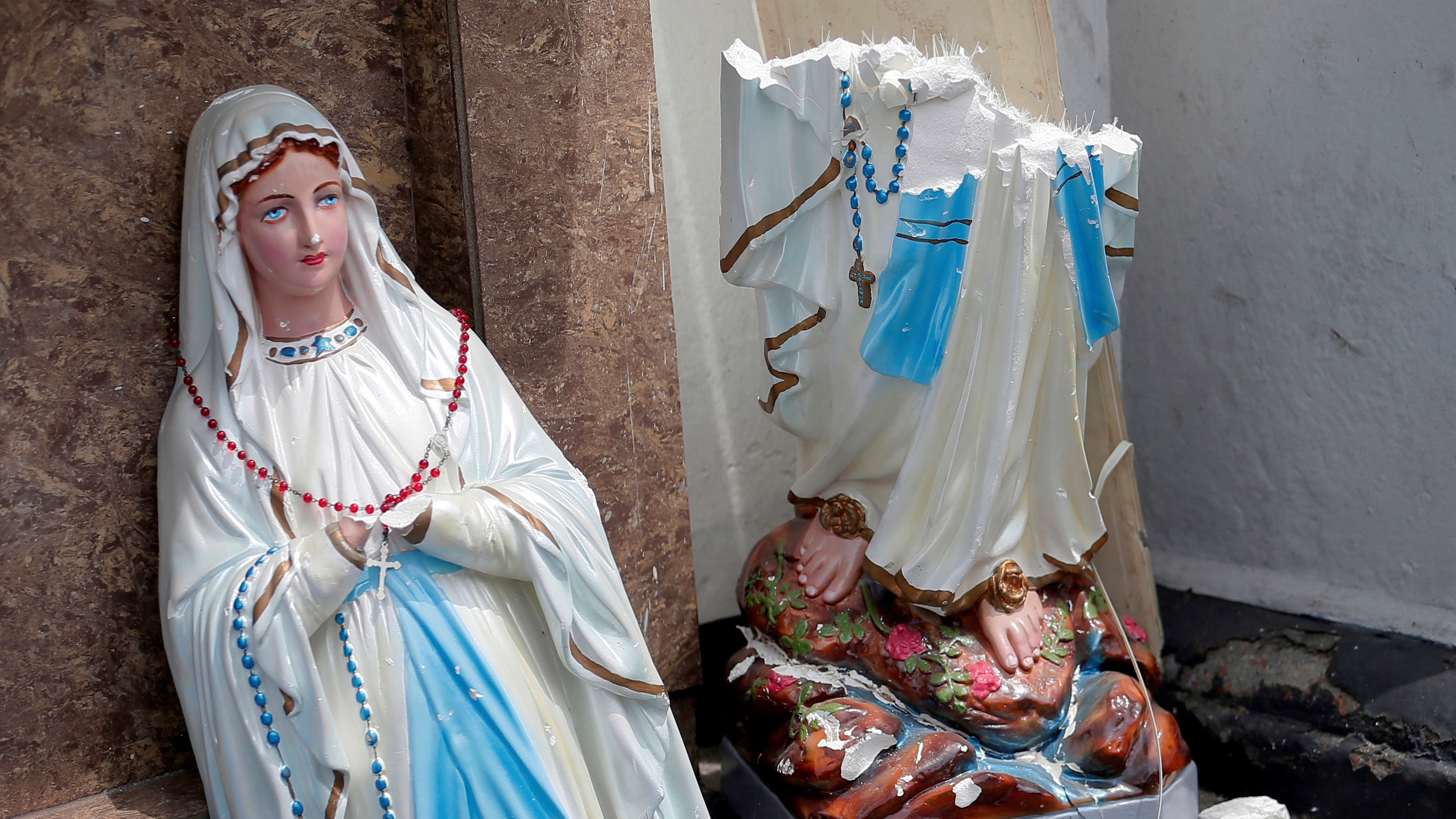 A statue of Virgin Mary in front of the St. Anthony's Shrine, Kochchikade church after an explosion in Colombo, Sri Lanka.