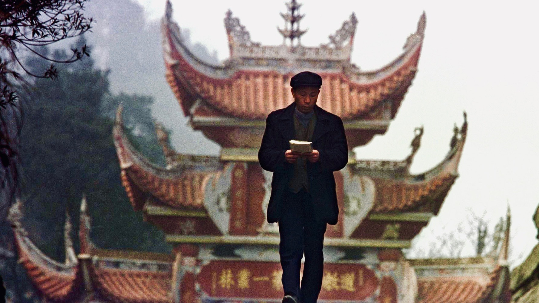 Man walking with a book.
