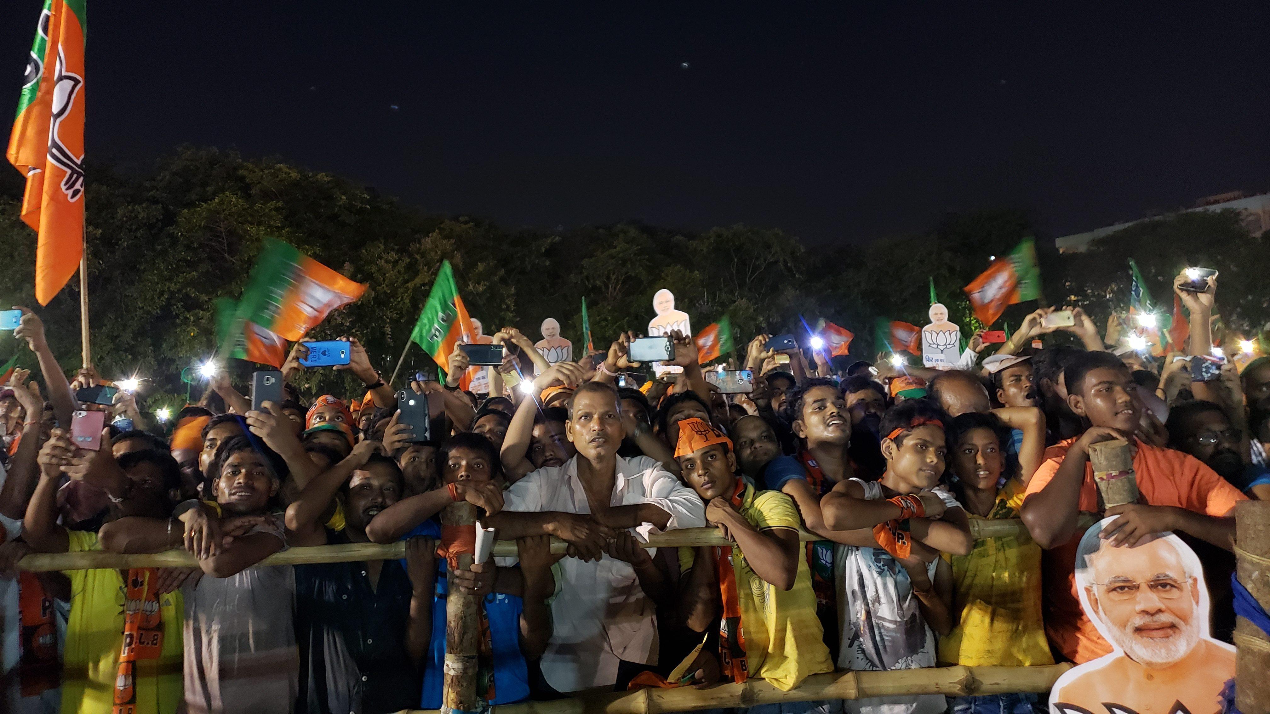 People listen to Narendra Modi in Dum Dum, Kolkata, on May 16.