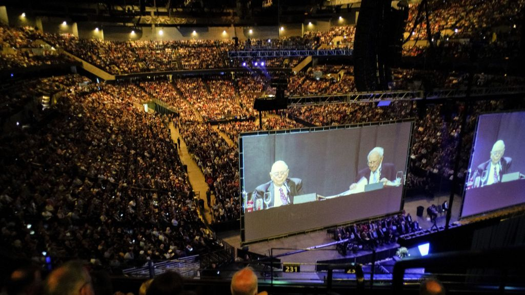 Warren Buffett, chairman and CEO of Berkshire Hathaway, right, and his Vice-Chairman Charlie Munger, are projected on large screens as they preside over a question and answer session during the annual shareholders meeting in Omaha, Neb., Saturday, May 5, 2018.