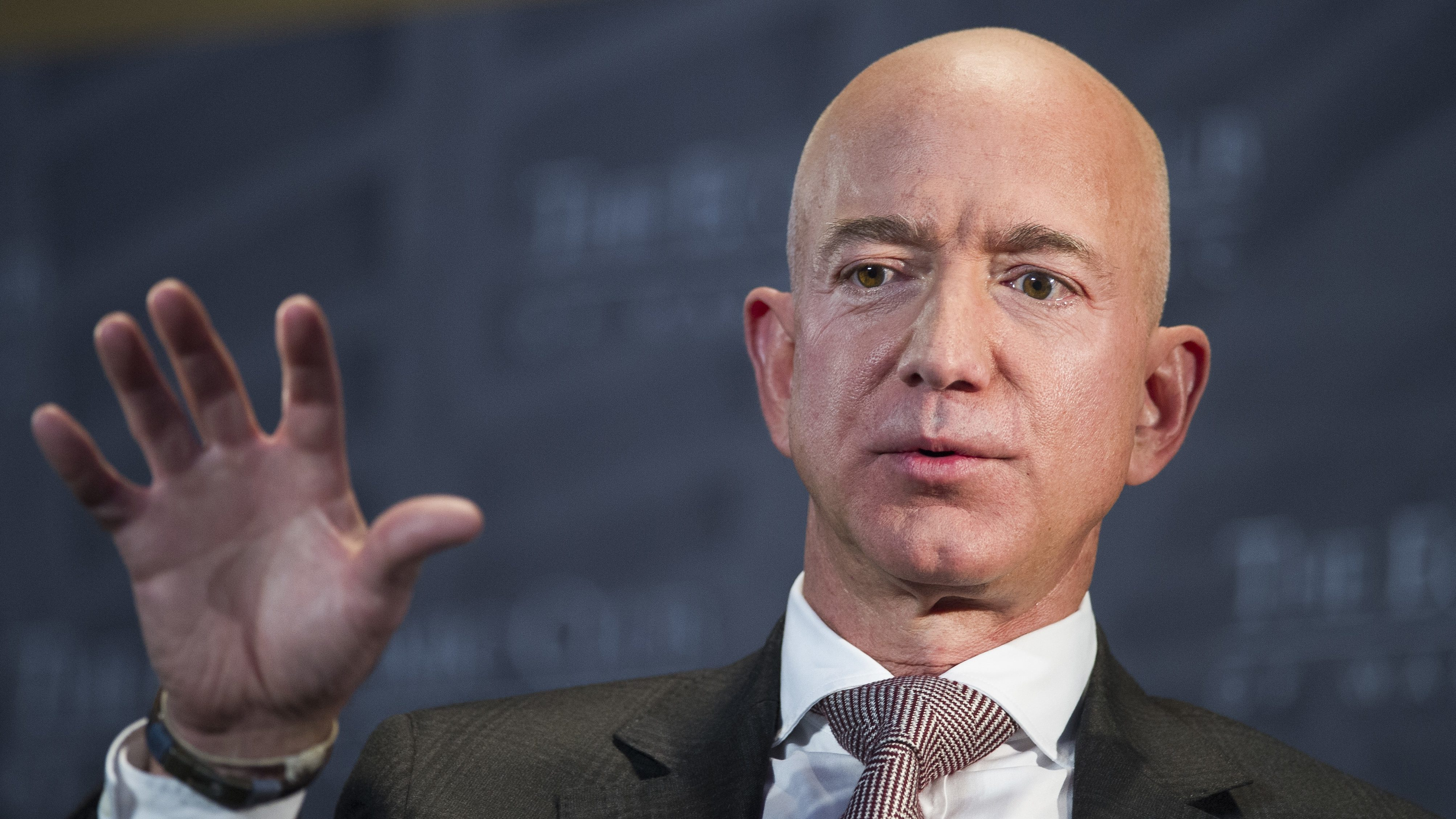 a close up of Jeff Bezos talking