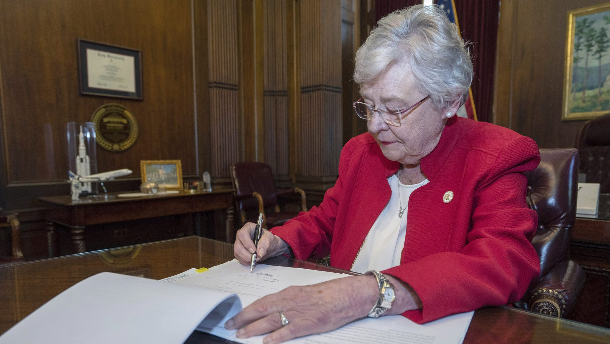 Kay Ivey signs abortion law