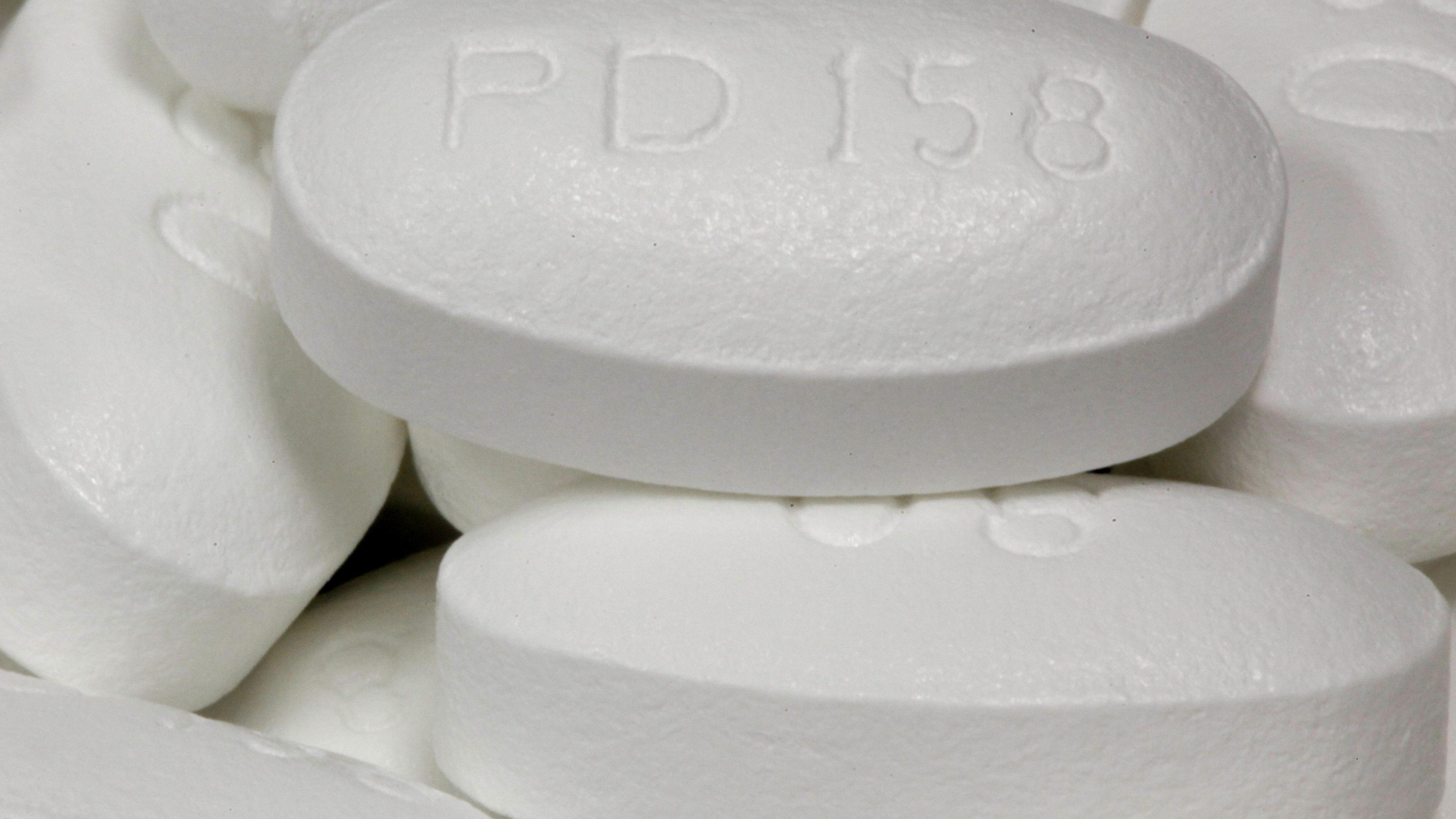 A close-up image of statin pills.