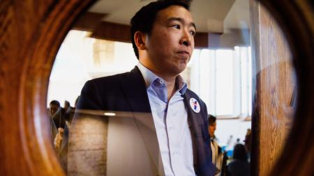 Democratic Presidential candidate Andrew Yang leaves Saturday, April 27, 2019, during the Reaching Rural Voters Rural Caucus Forum at the Saints Center for Culture and the Arts in Stuart, Iowa.