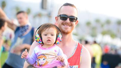 A young music fan and his father pose for a photo at the 2015 Coachella Music and Arts Festival on Friday, April 10, 2015, in Indio, Calif. (Photo by Scott Roth/Invision/AP)