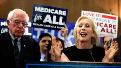 Sen. Kirsten Gillibrand, D-N.Y. with Sen. Bernie Sanders, I-Vt., speaks at a gathering introducing the Medicare for All Act of 2019, on Capitol Hill in Washington, Wednesday, April 10, 2019.