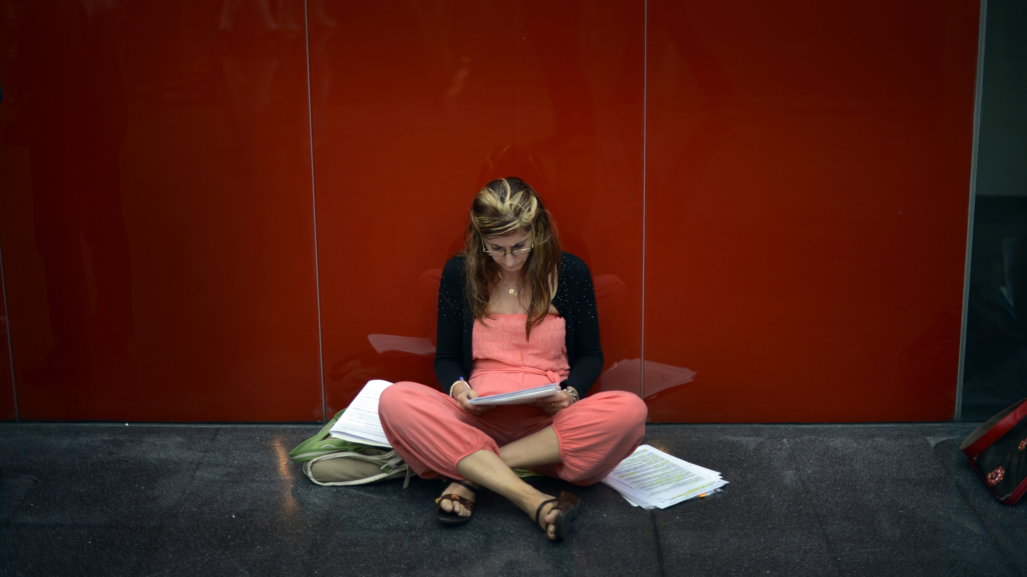 A woman studies before taking the Basque Government public health service.