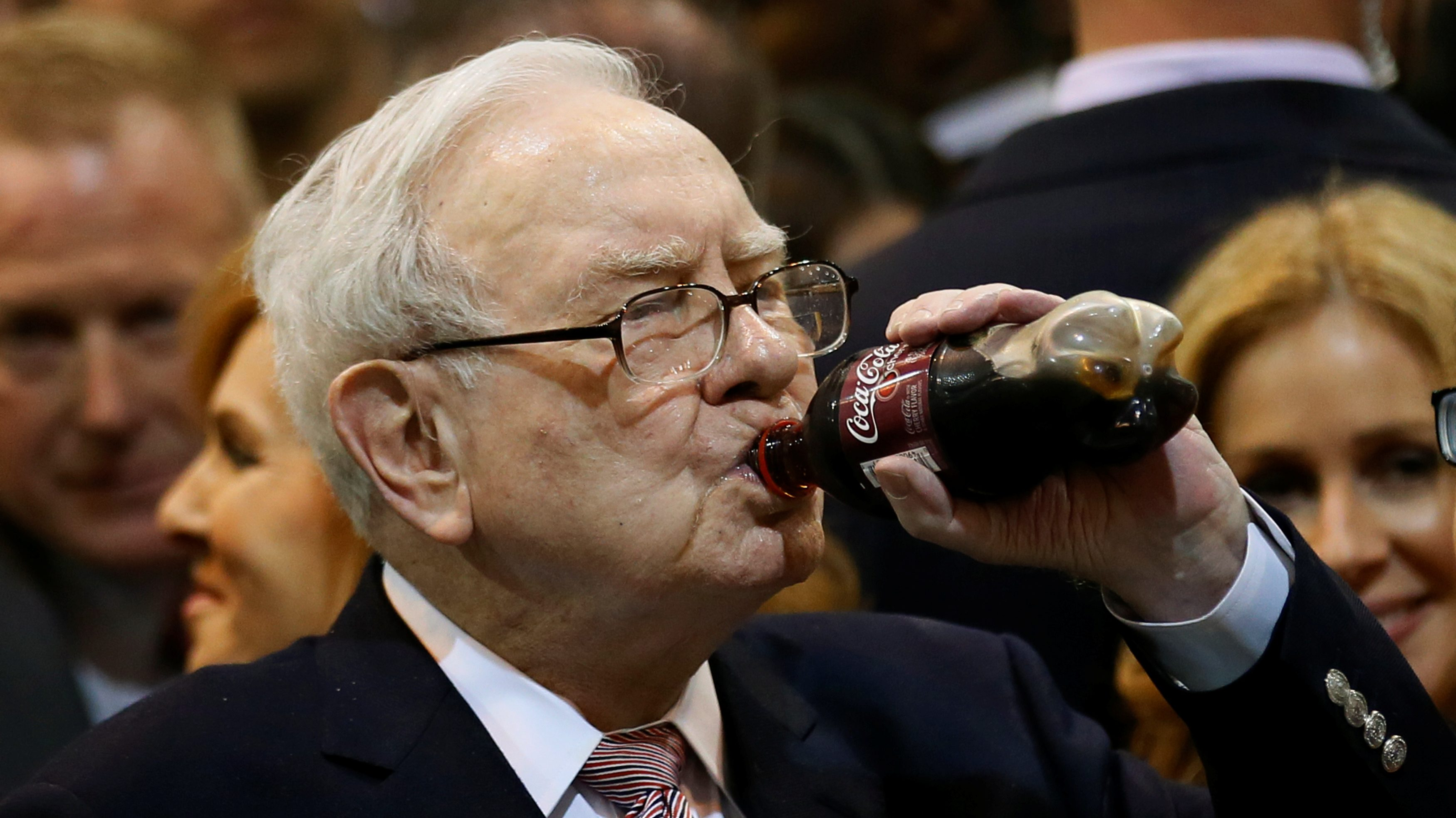 Berkshire Hathaway chairman and CEO Warren Buffett enjoys his favourite beverage, cherry Coke, before the Berkshire Hathaway annual meeting in Omaha