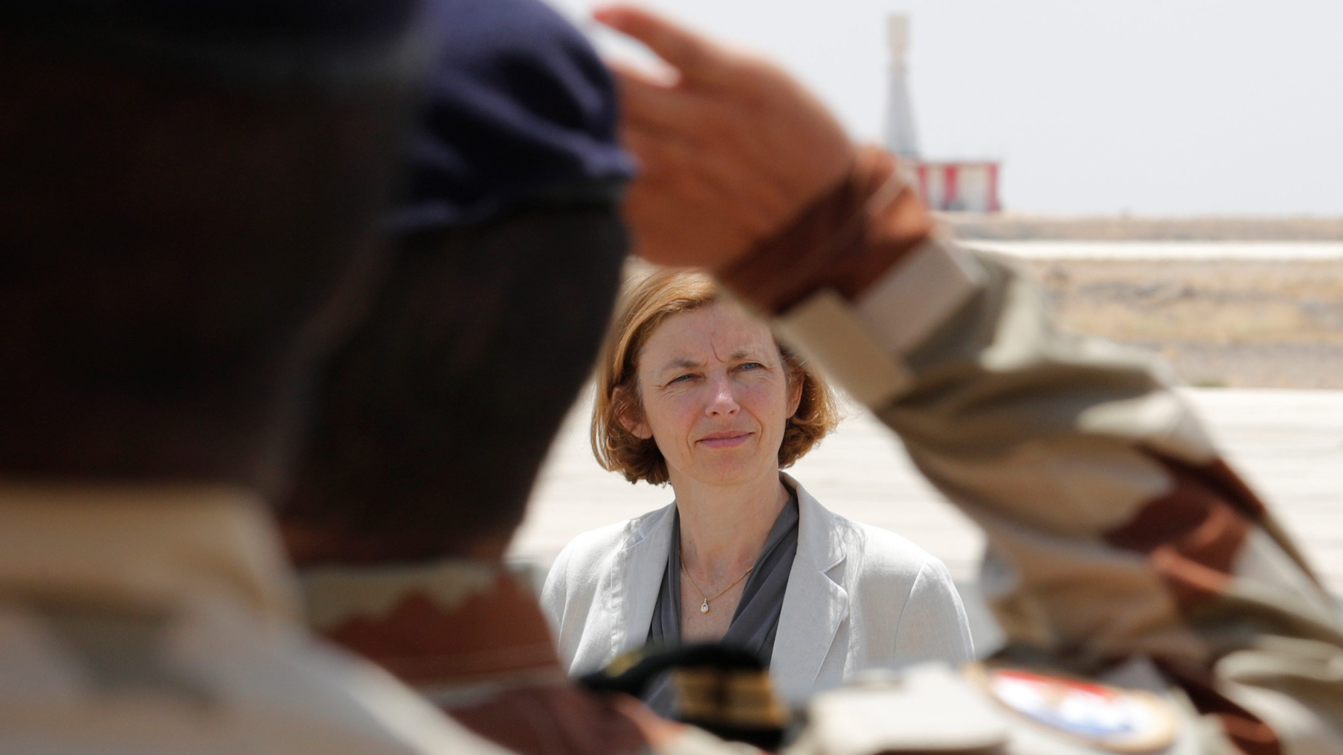 Florence Parly of France reviews troops.