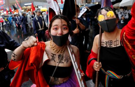 Protesters participate in a rally against Japan's imperial system