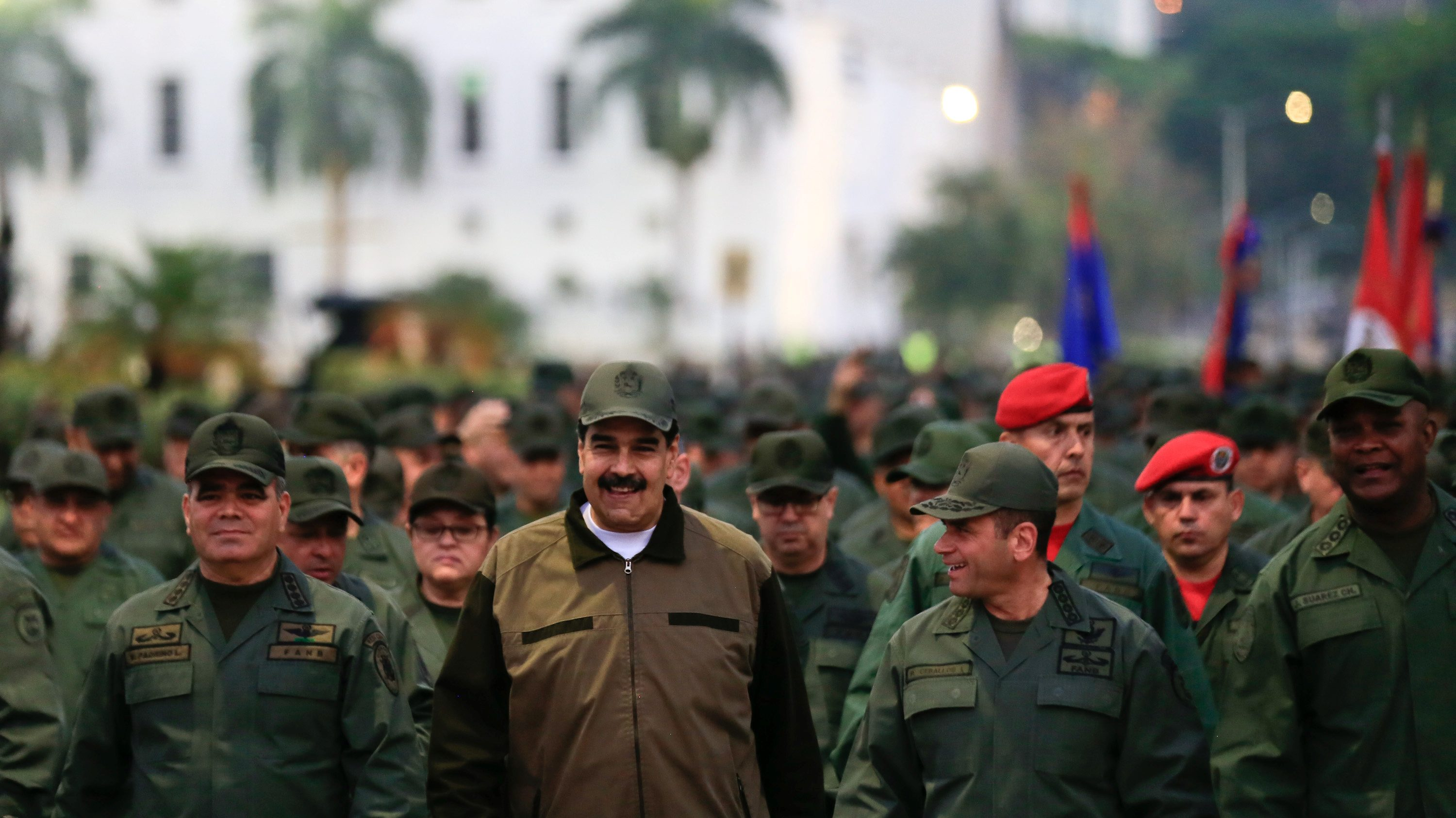 Venezuela's President Nicolas Maduro smiles as he walks next to Venezuela's Defense Minister Vladimir Padrino Lopez and Remigio Ceballos, Strategic Operational Commander of the Bolivarian National Armed Forces, during a ceremony at a military base in Caracas, Venezuela May 2, 2019.