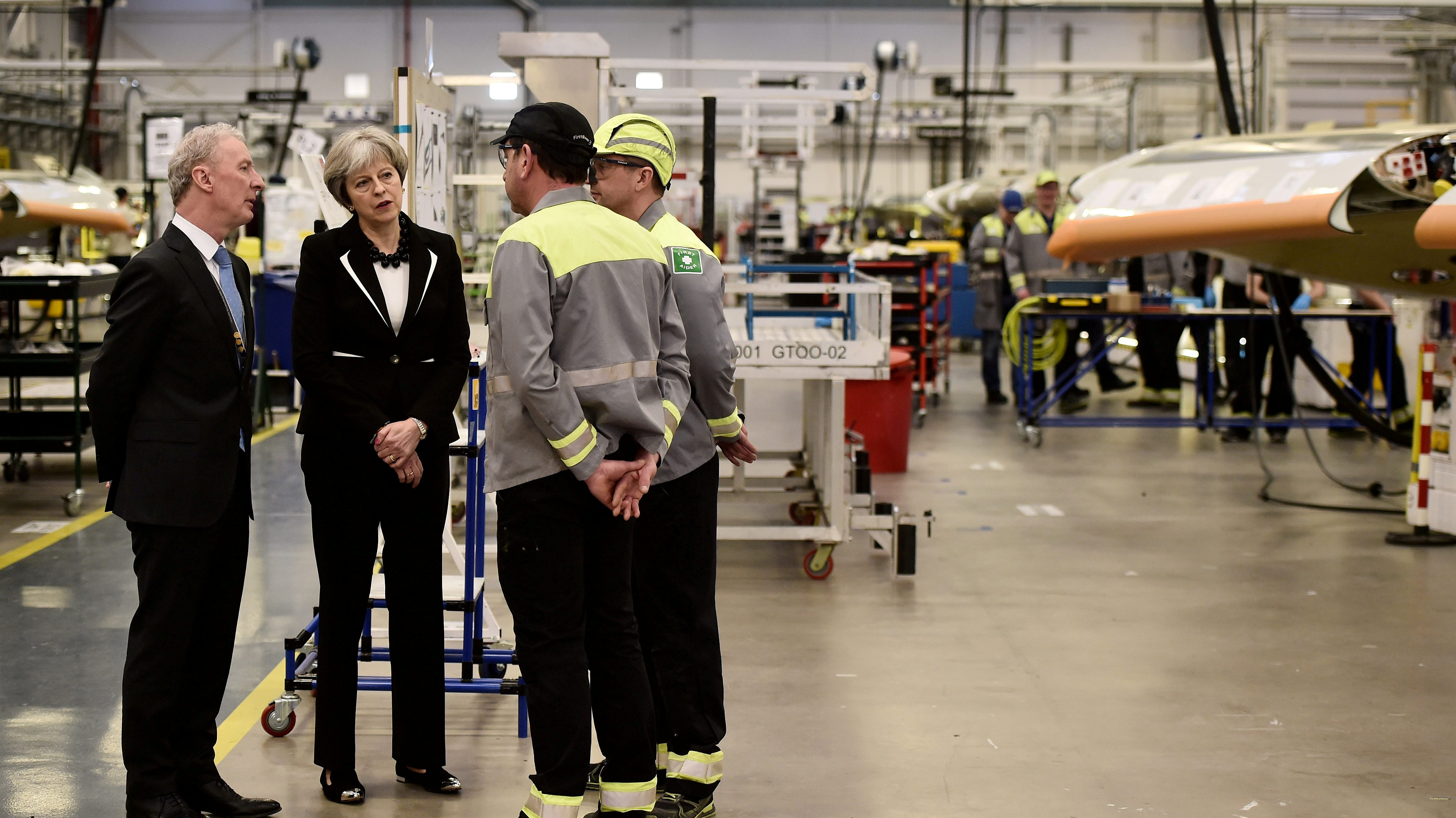 Britain's Prime Minister Theresa May speaks to workers at a factory