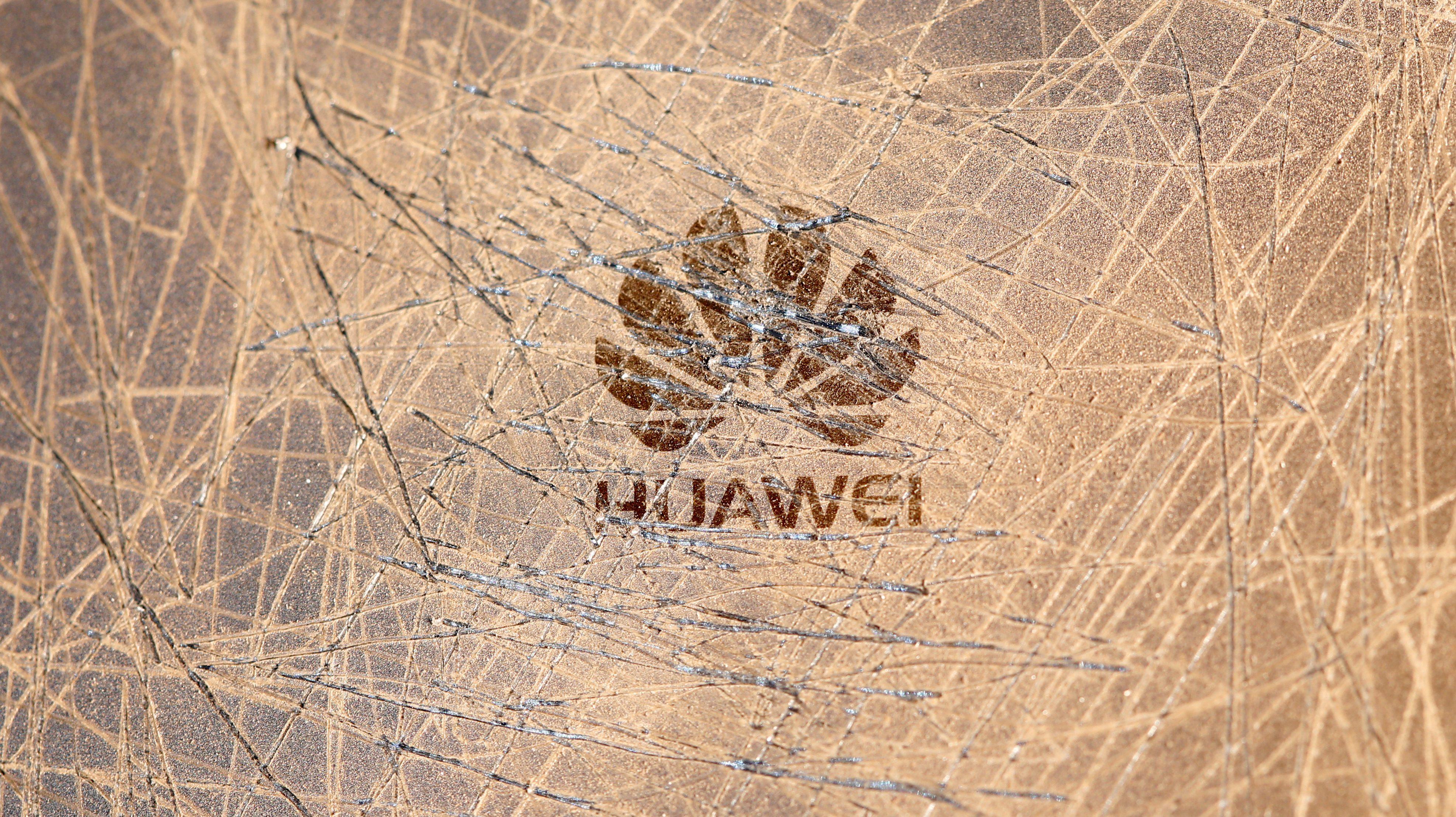 Scratched-up Huawei logo