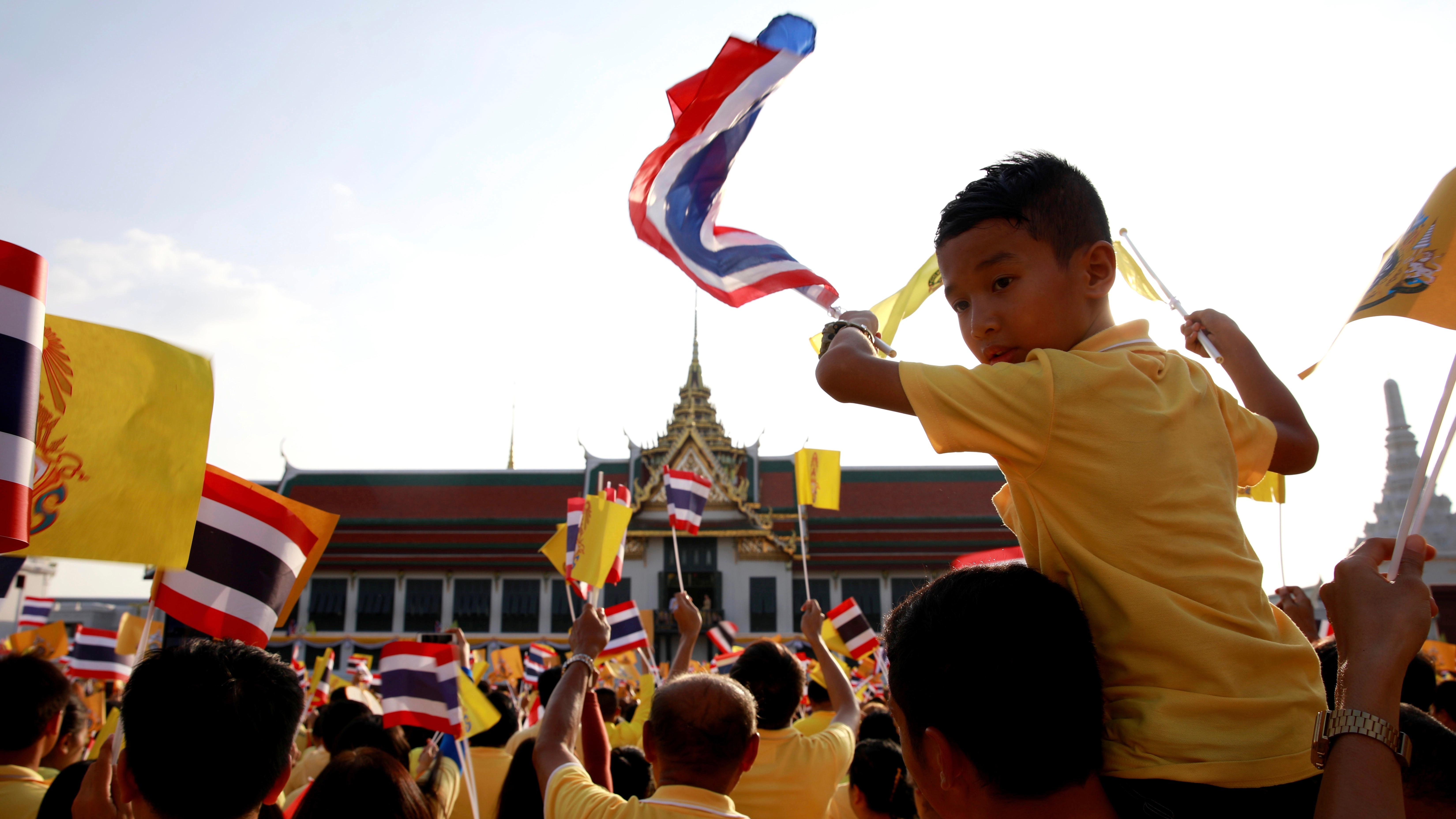 Bangkok cheers a new Thai king.