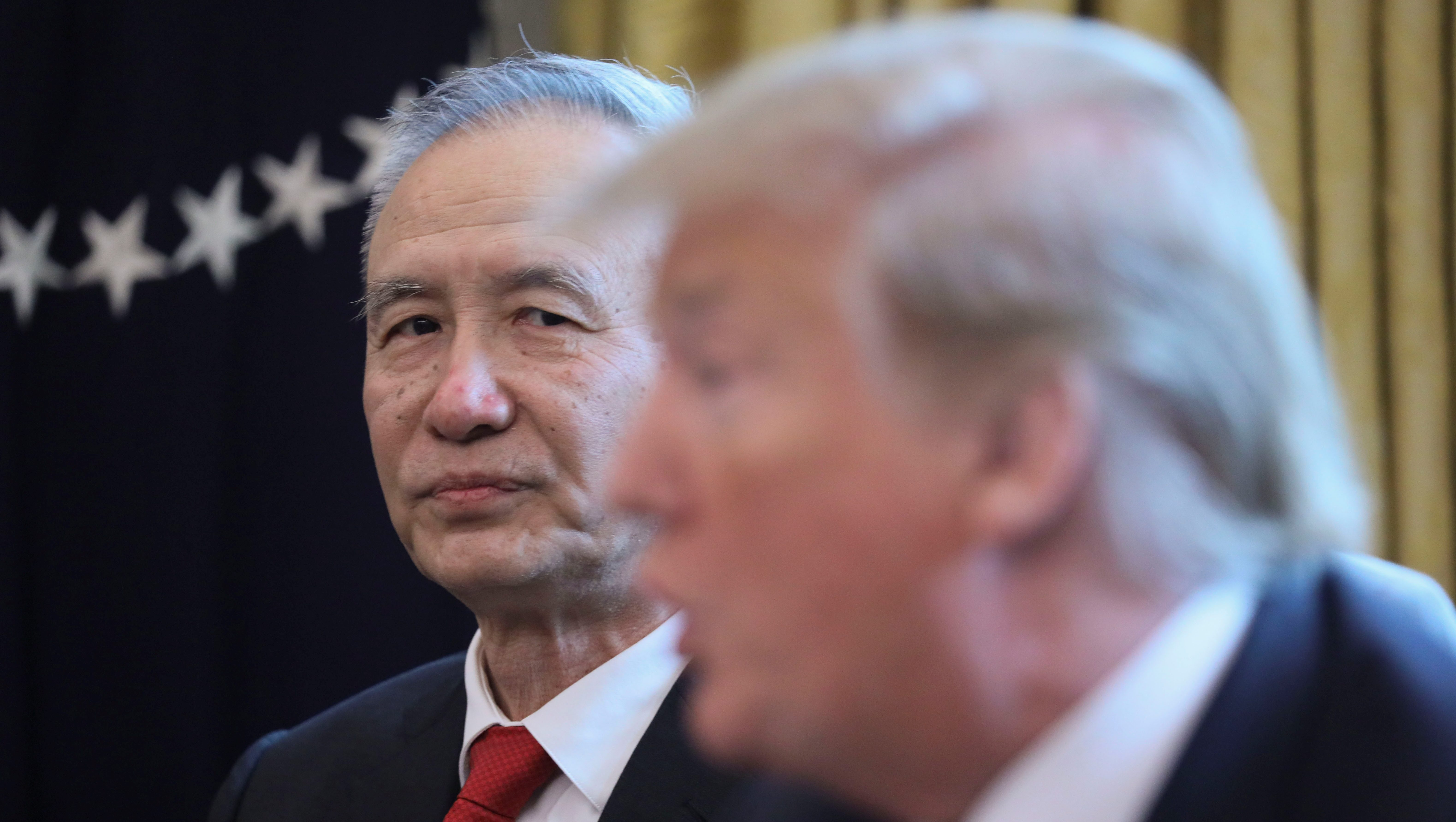 China's Vice Premier Liu He listens to U.S. President Trump as they meet in the Oval Office at the White House in Washington, U.S., April 4, 2019.