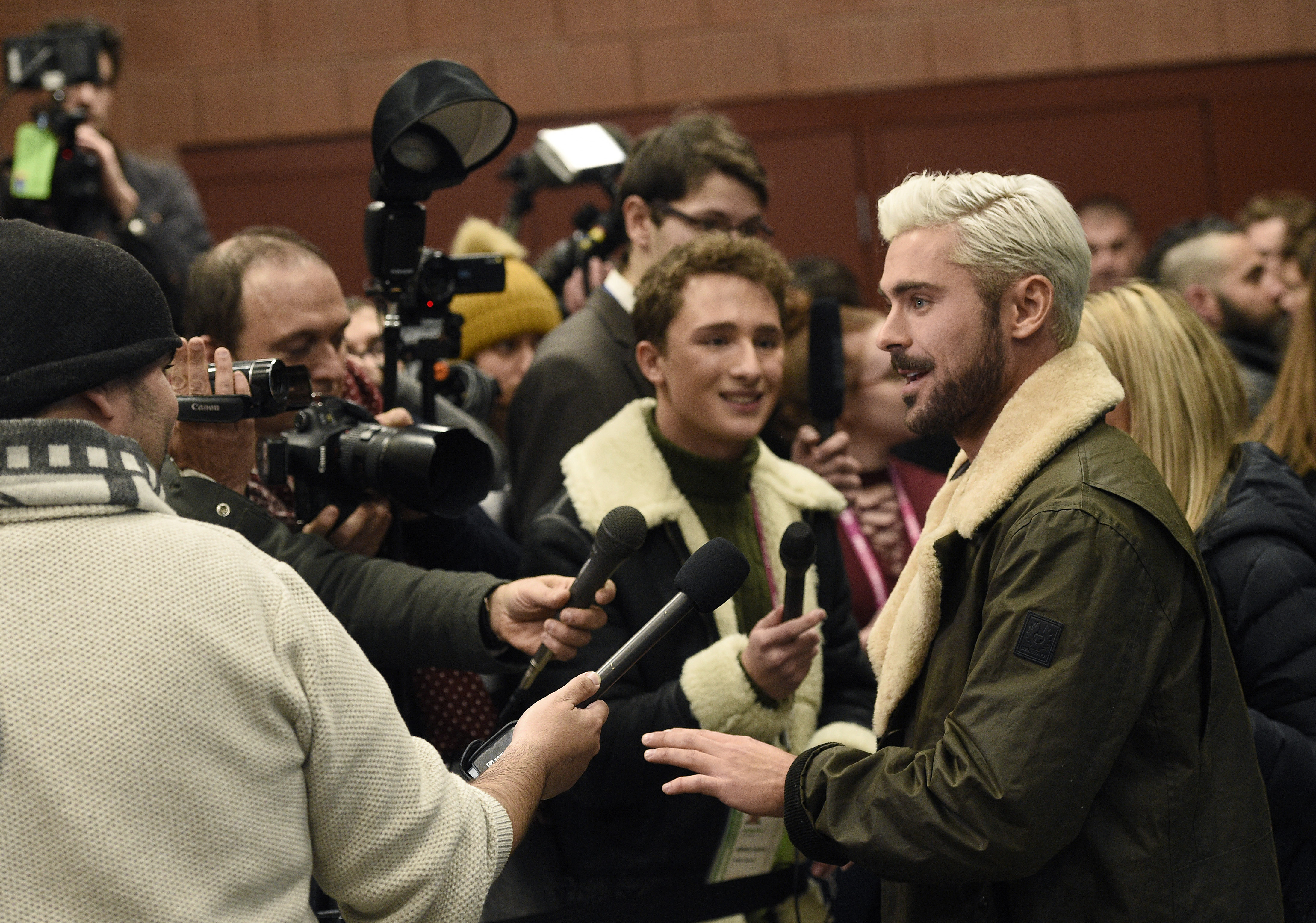 "Zac Efron, right, who portrays serial killer Ted Bundy in ""Extremely Wicked, Shockingly Evil and Vile,"" works the press line at the premiere of the film during the 2019 Sundance Film Festival, Saturday, Jan. 26, 2019, in Park City, Utah."