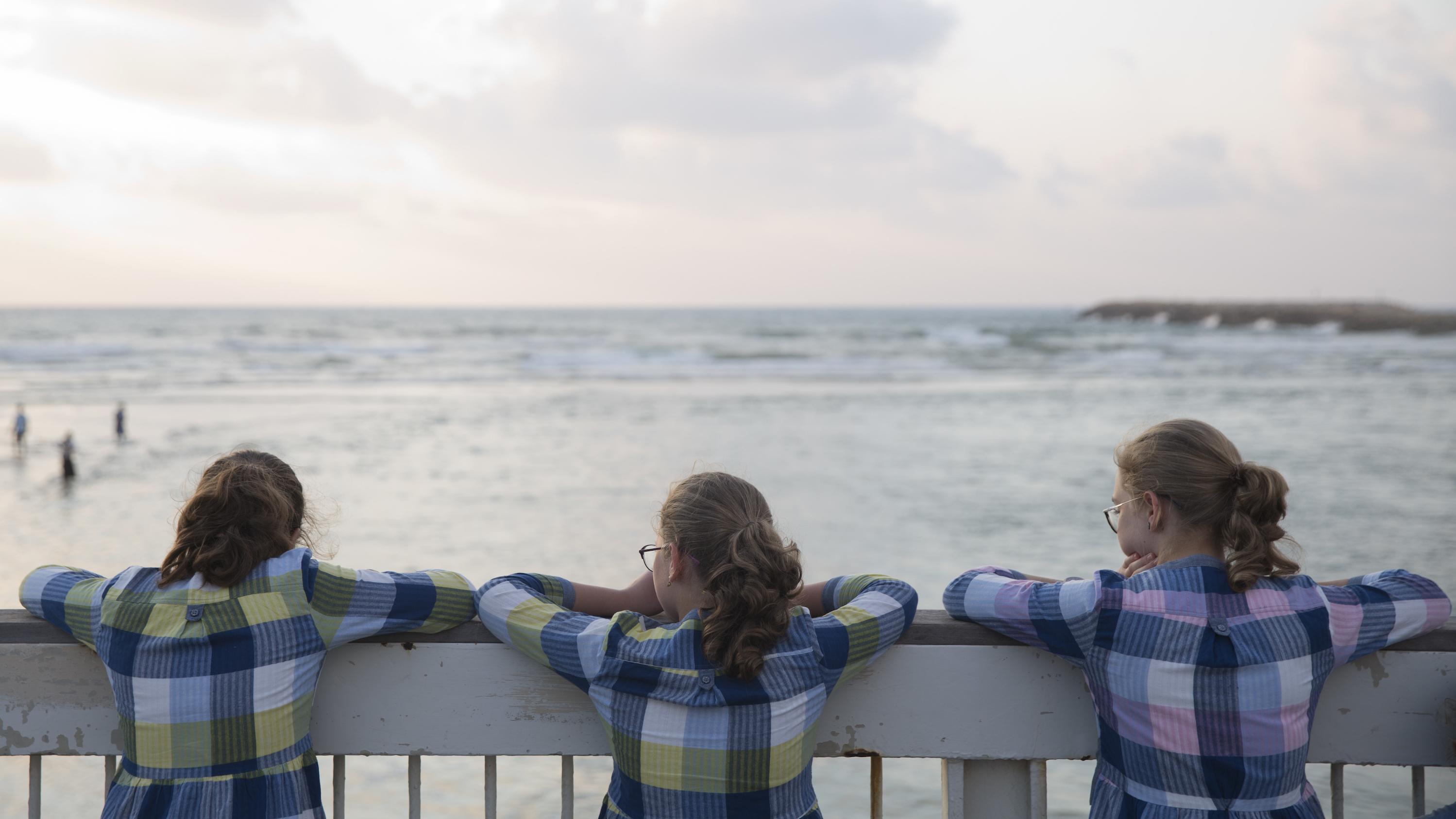 girls looking at sea