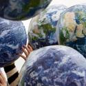 People hold up inflatable world globes during World Environment Day celebrations in central Sydney