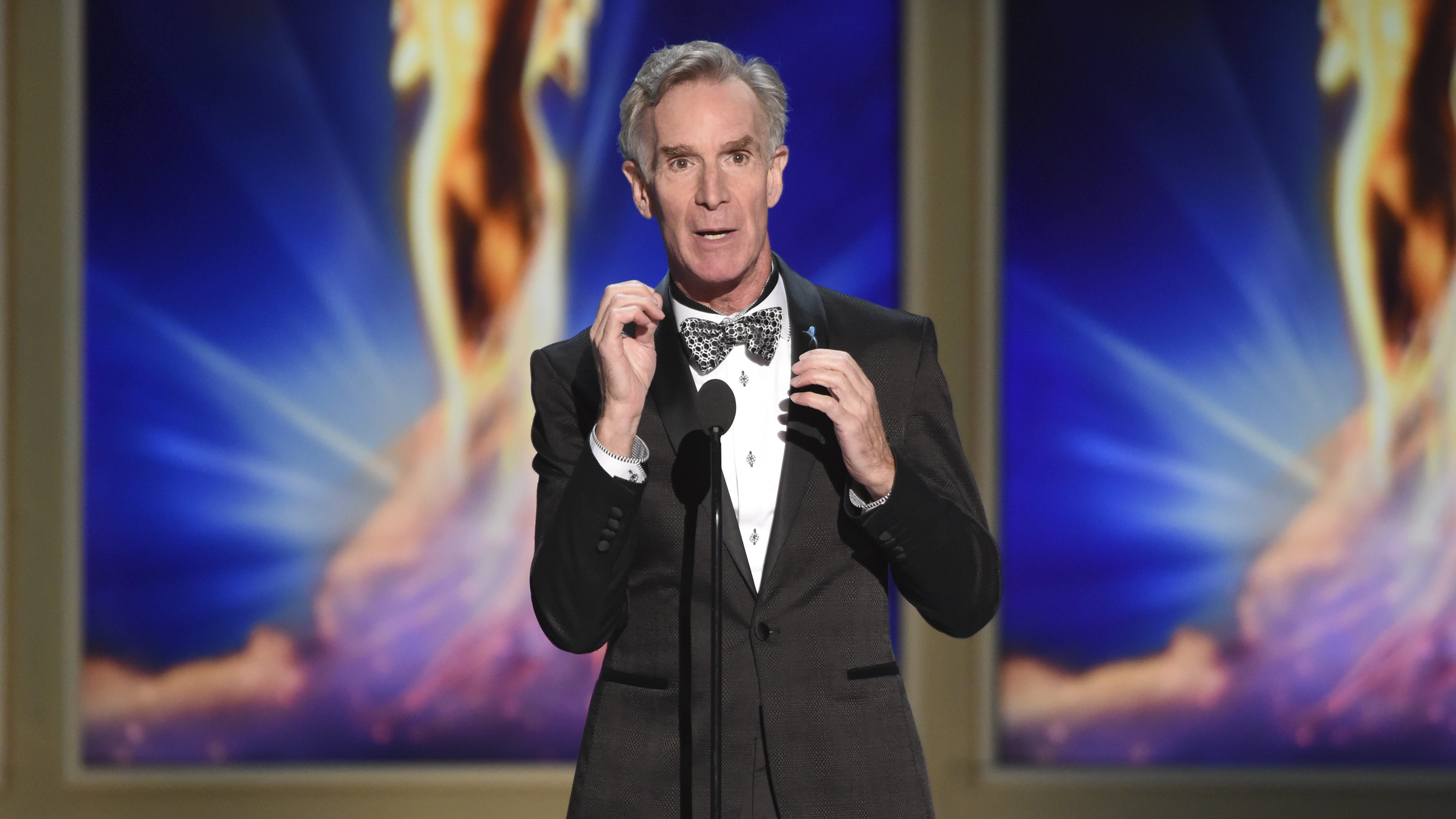 An image of Bill Nye speaking at a television event.