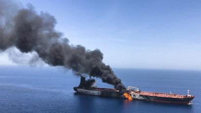 A flaming oil tanker in the sea of Oman.