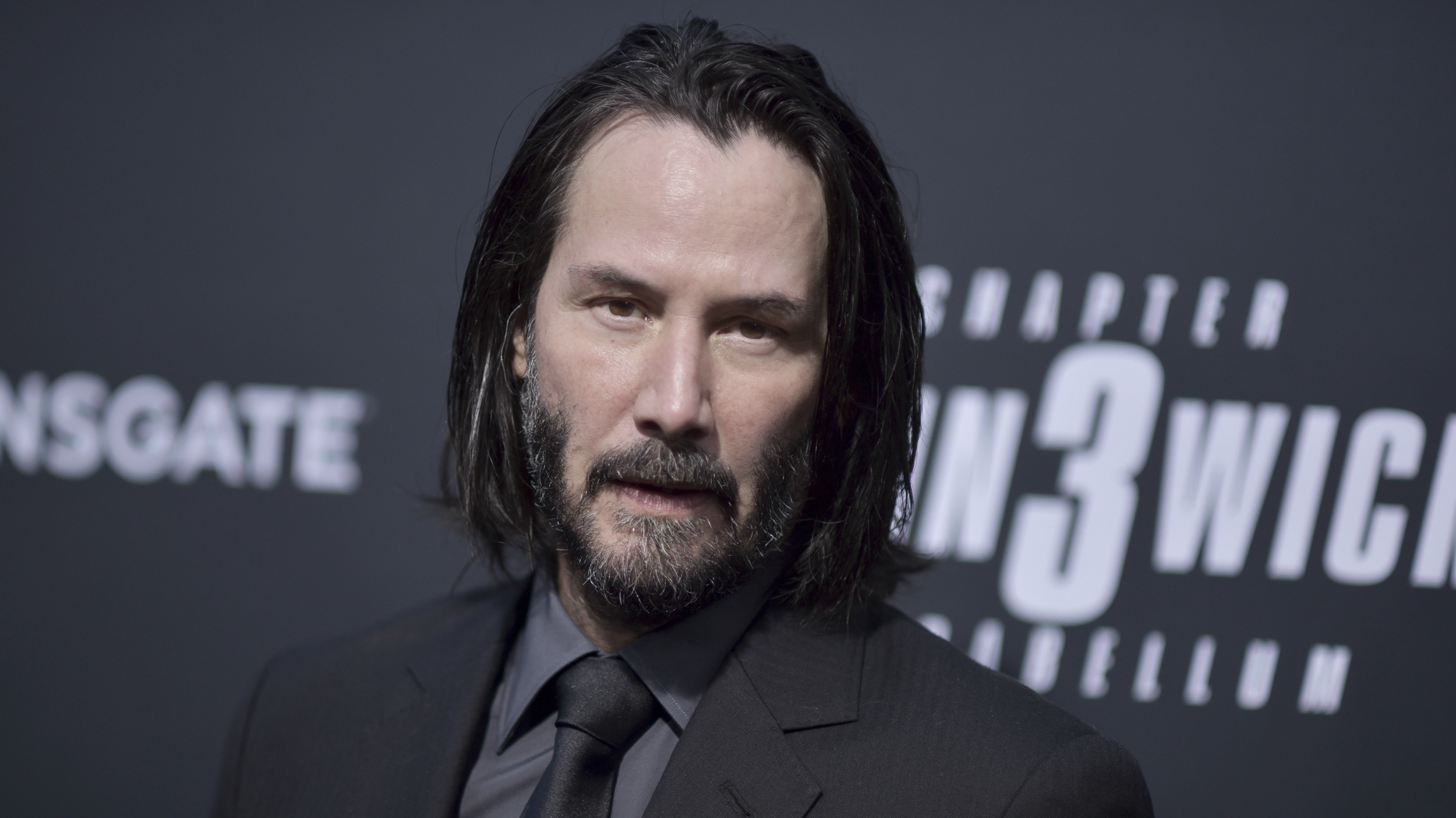 An image of Keanu Reeves at the John Wick 3 premier.