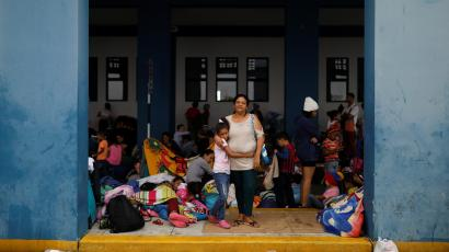 Venezuelan migrant Suramay Farias, 47, poses for a picture with her daughter Franchesca, 8, while they wait to process their documents at the Ecuadorian-Peruvian border service centre