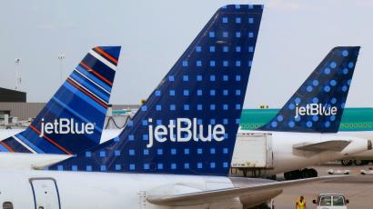 JetBlue Airways aircraft at departure gates at John F. Kennedy International Airport in New York