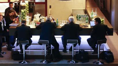 Participants sit at a bar during the annual meeting of the World Economic Forum (WEF) in Davos