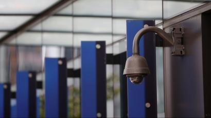 A security camera outside an Amazon building.