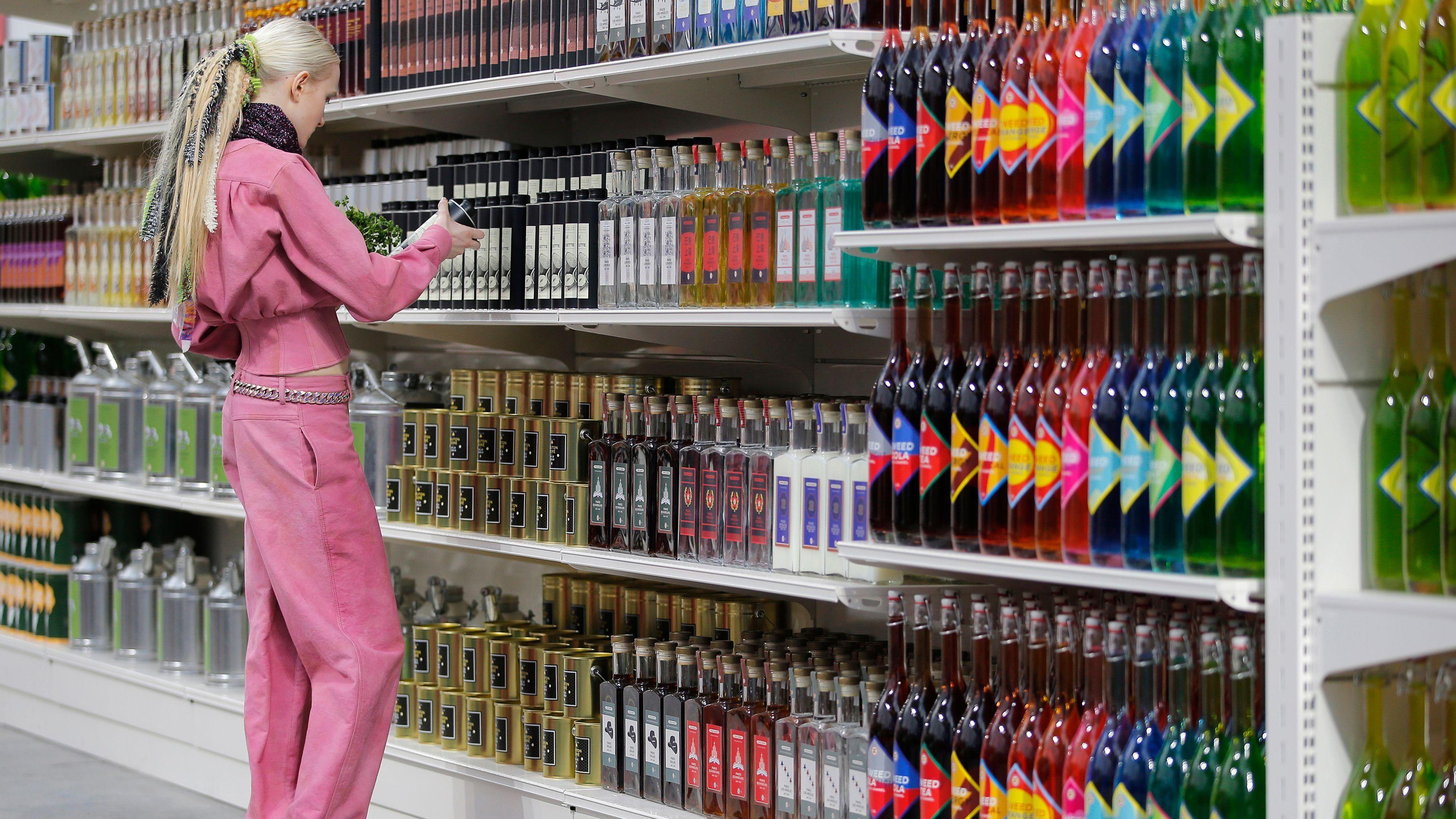 shopper in supermarket shelves