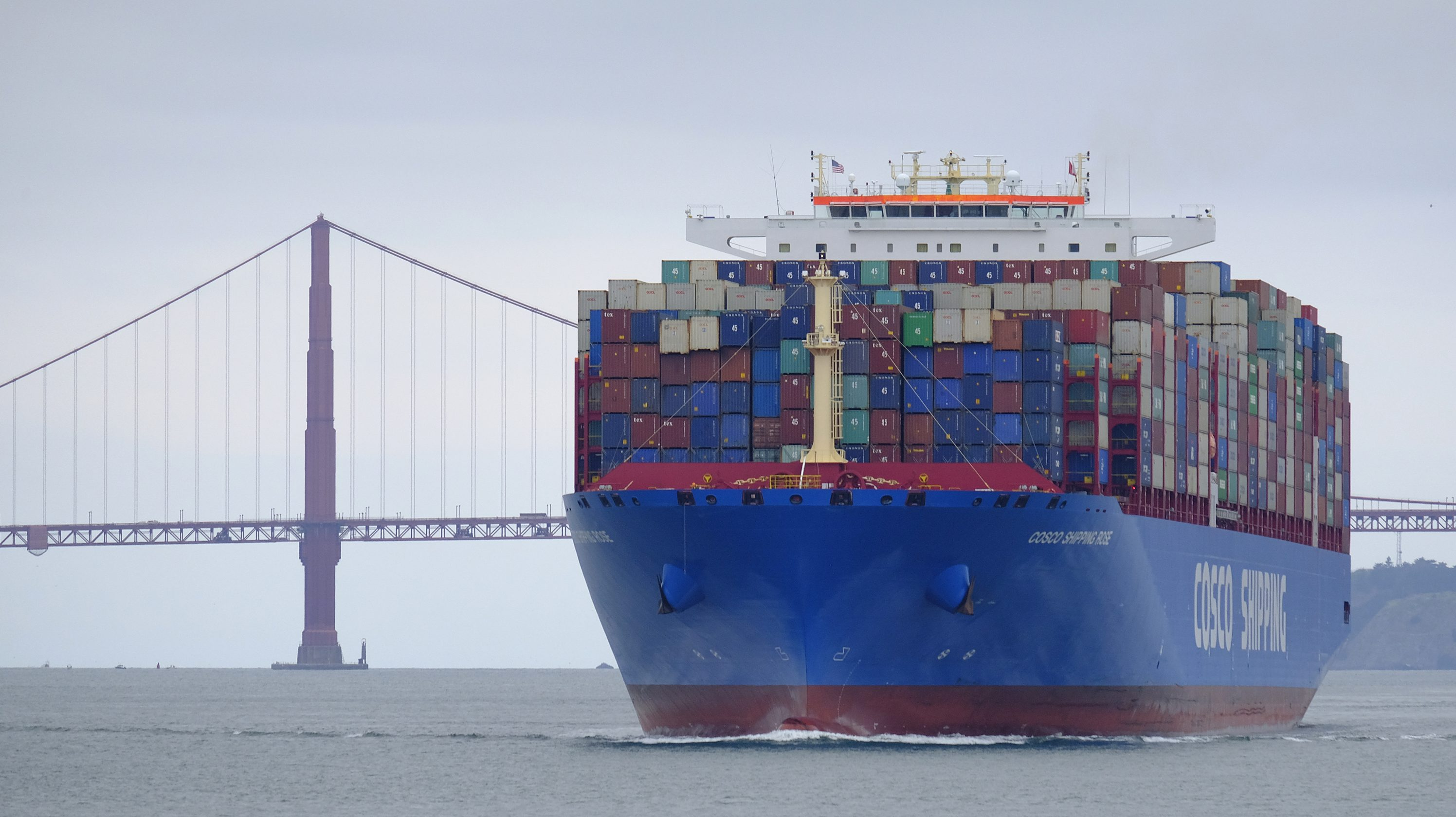 A Cosco Shipping container ship passes the Golden Gate Bridge Tuesday, May 14, 2019, in San Francisco bound for the Port of Oakland.