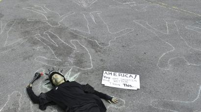 Protestor in statue of liberty costume