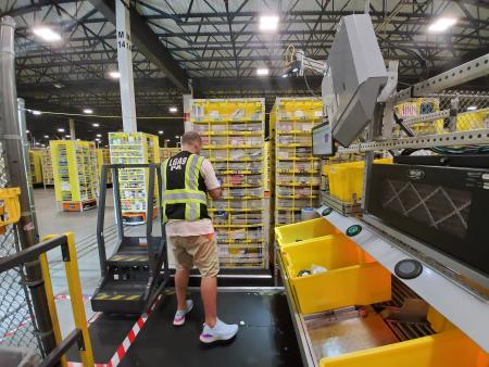 Amazon worker picking products from shelves