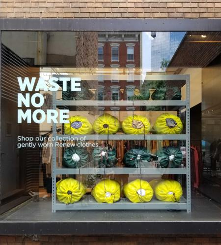 "A store window with the text ""Waste No More"""