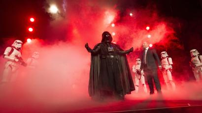 """Disney Consumer Products Executive Vice President Josh Silverman is interrupted by """"The Imperial March"""" led by Darth Vader and 20 Stormtroopers as they take over the stage during a private Disney event at the Licensing Expo, Monday June 17, 2013"""