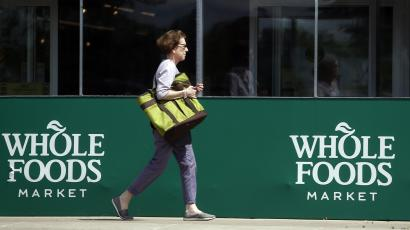 A shopper heads into Whole Foods.