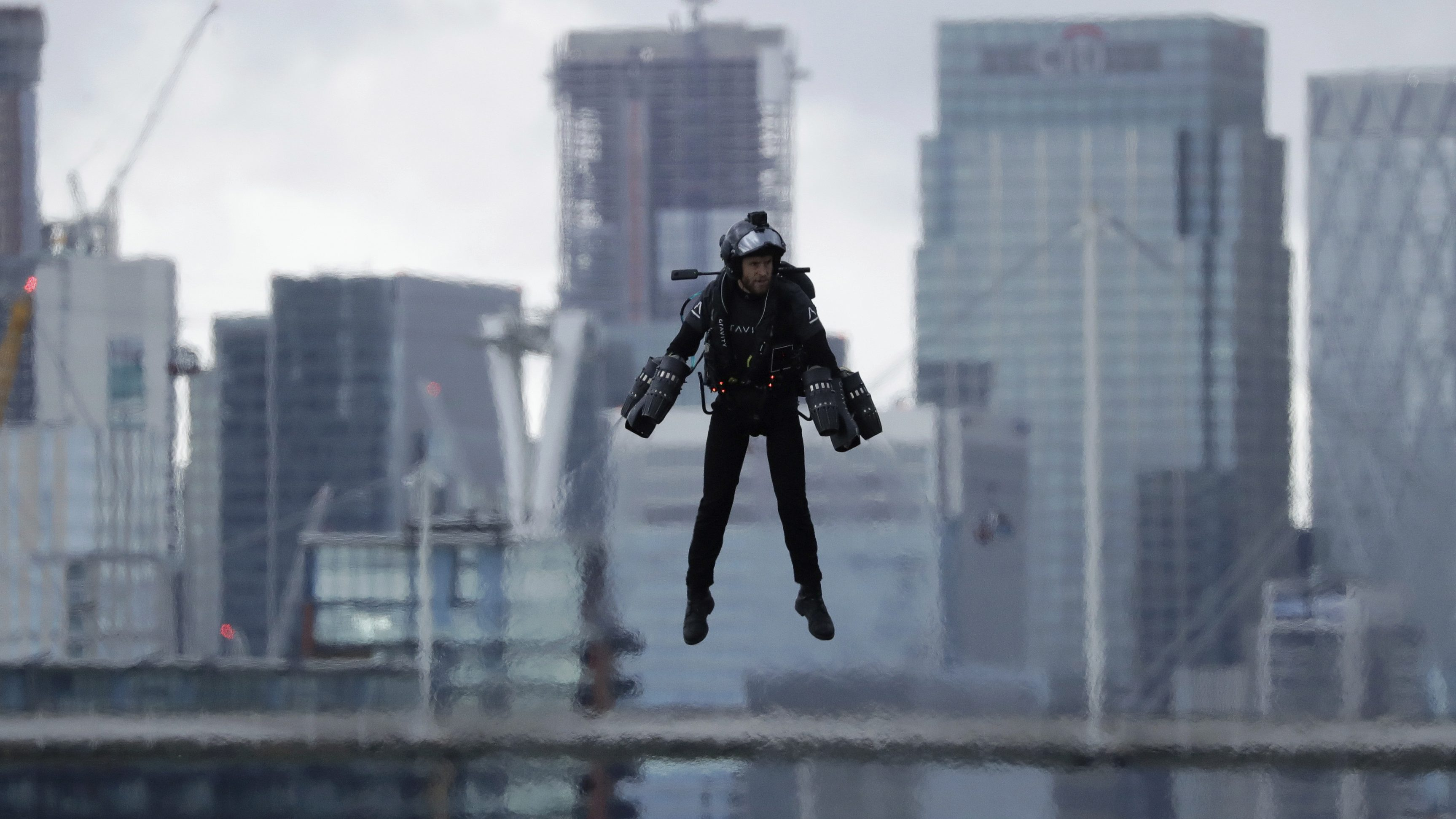 a man flying in a jetpack
