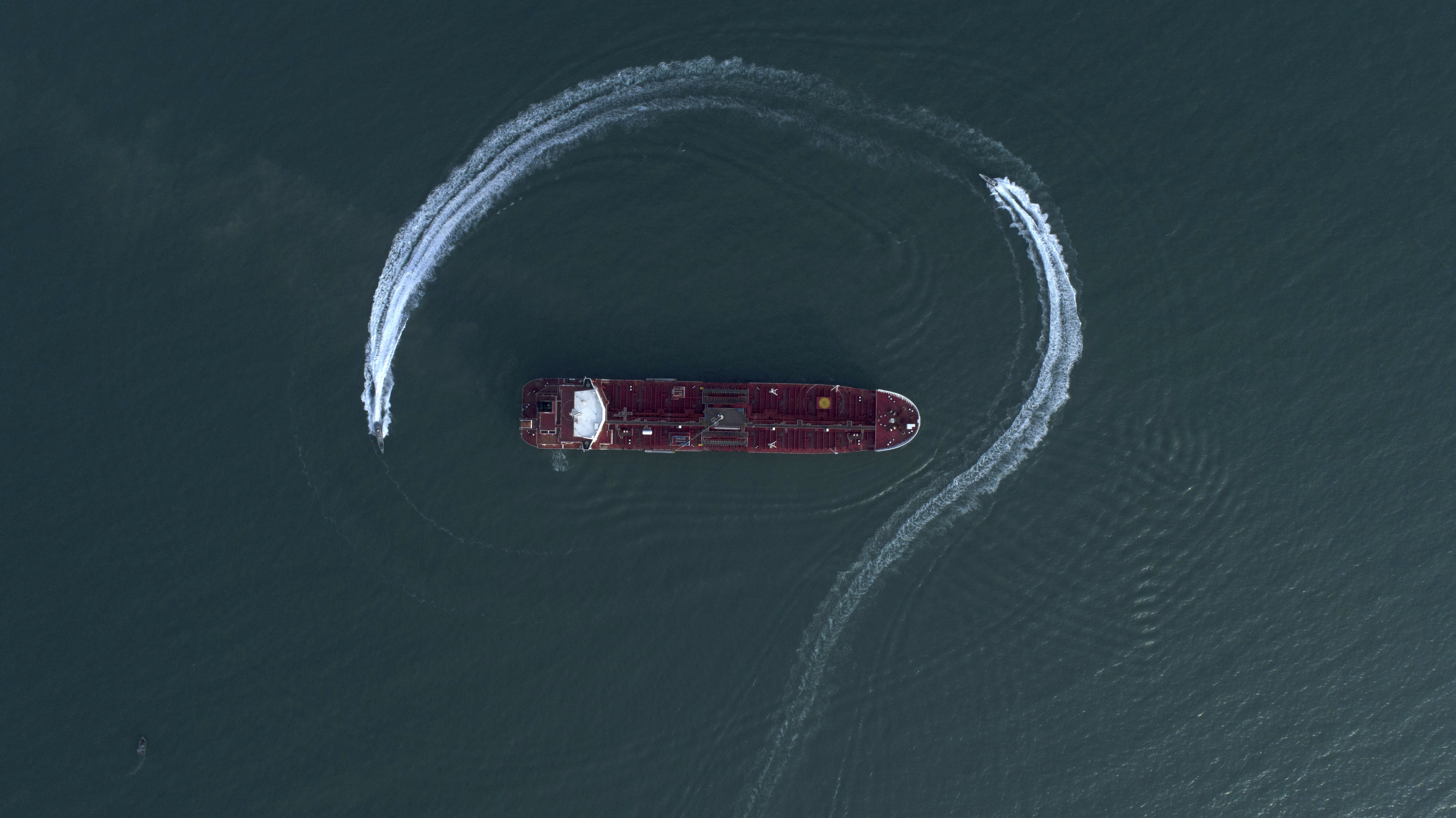 an aerial view shows a speedboat of Iran's Revolutionary Guard moving around the British-flagged oil tanker Stena Impero